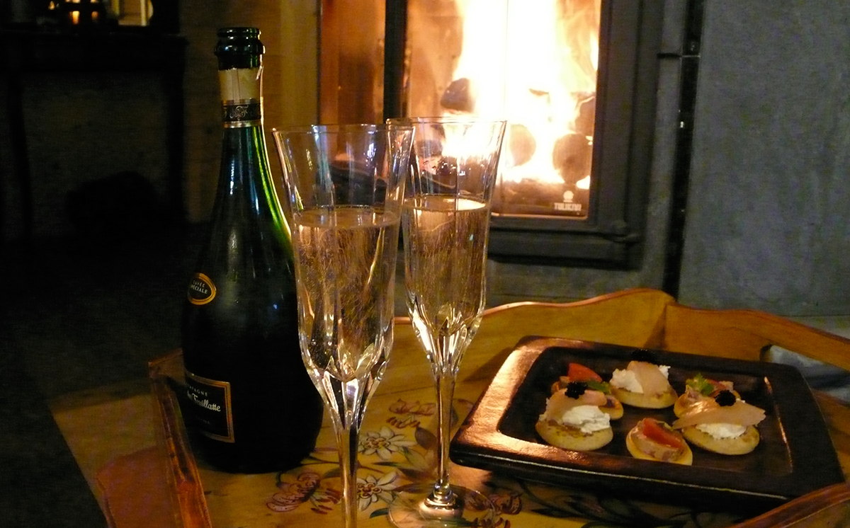 Relax with champaign in front of a roaring fire