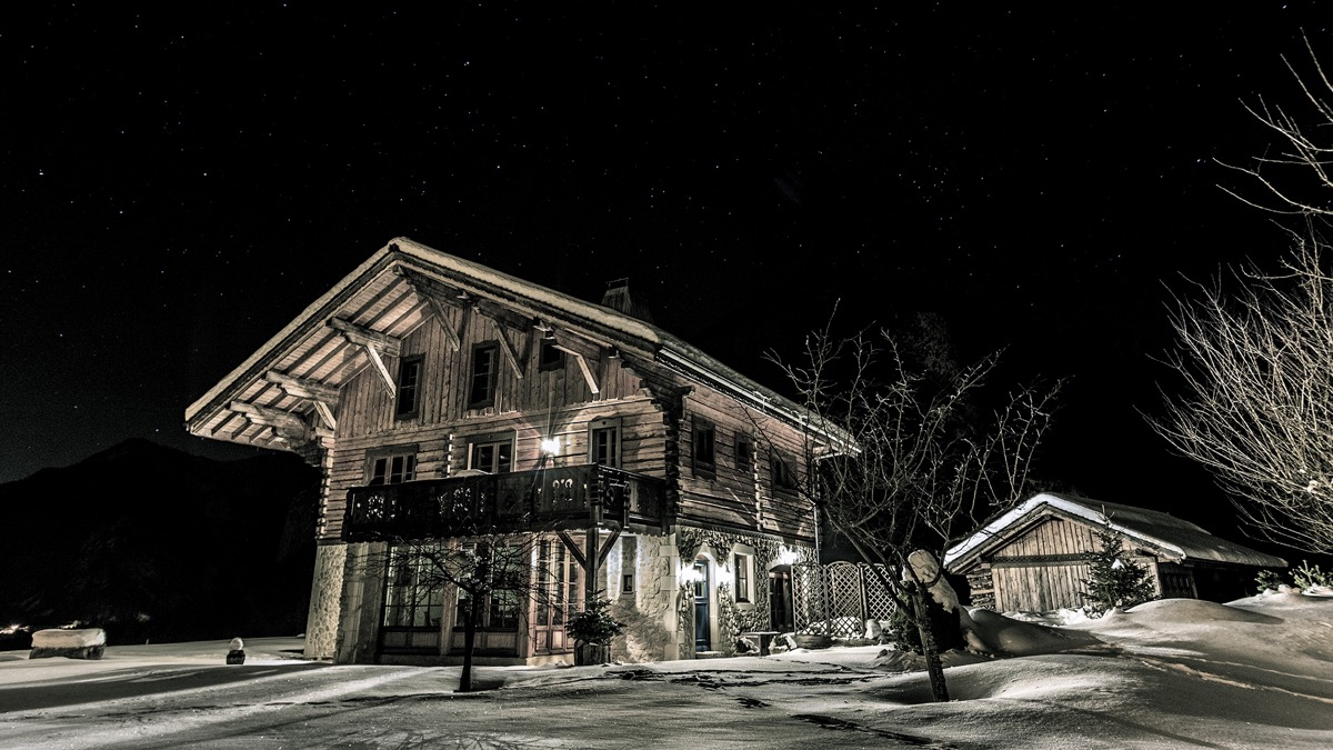 The beatiful chalet against a night backdrop
