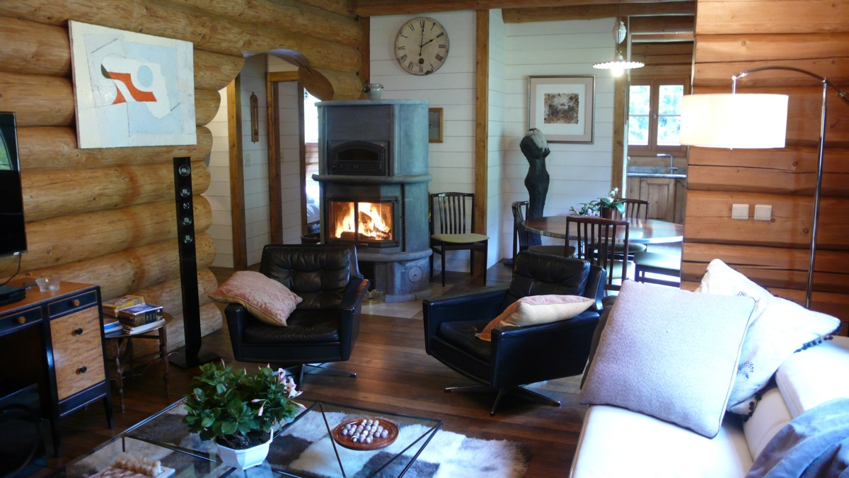 A roaring log fire is the centre piece of the room